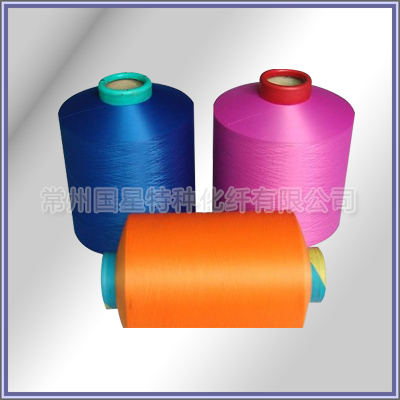 Flame retardant polyester low elastic yarn